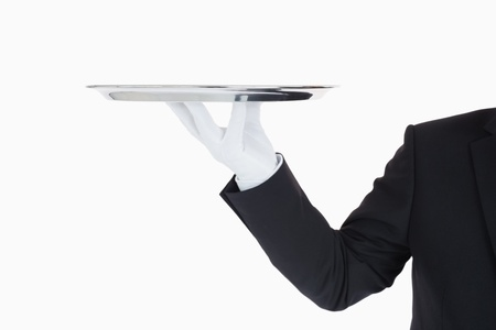 Hand with gloves holding a silver tray in front of camera Stock Photo - 16069182