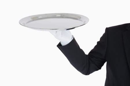 Hand with white gloves holding a silver tray in front of camera Stock Photo - 16069422