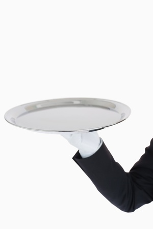 silver tray: White gloved hand holding a silver tray in front of camera