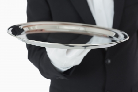 Waiter holding a silver tray in front of camera Stock Photo - 16075757