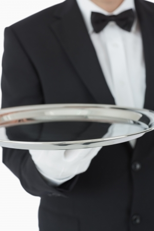 Waiter holding silver tray in front of camera Stock Photo - 16076102