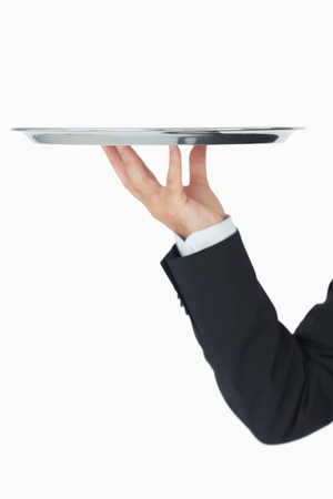 Well-dressed man holding silver tray on white backgroud Stock Photo - 16069137
