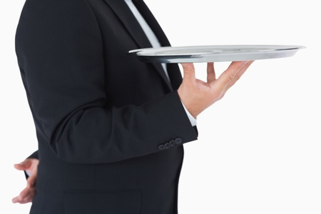 Waiter standing and holding a silver tray on white background Stock Photo - 16075325