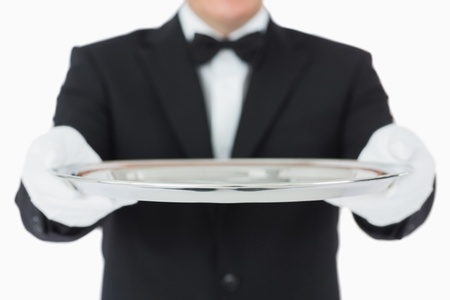 Waiter holding a silver tray with both hands on white background Stock Photo - 16075604