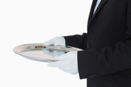 Man in suit holding silver tray on white background Stock Photo - 16075046