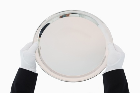 Silver tray being held out by man in suit and gloves Stock Photo - 16069584