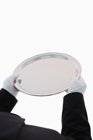 Large silver tray being held out on white background Stock Photo - 16069682