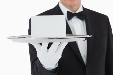 silver service: Man holding silver tray with white blank card Stock Photo