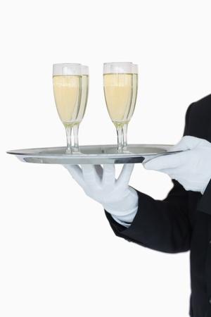 Waiter holding tray of champagne flutes on white background Stock Photo - 16069228