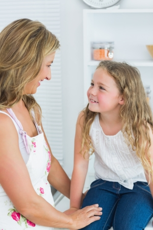 Smiling mother and daughter looking into each other's eyes Stock Photo - 16076447