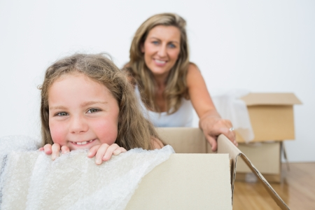Smiling girl sitting on the box photo