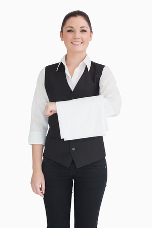 Smiling woman holding dishtowel on forearm photo