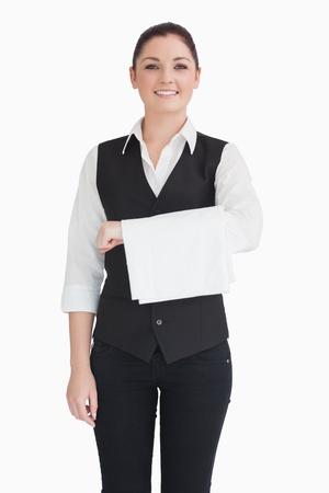 dishtowel: Smiling woman holding dishtowel on forearm Stock Photo