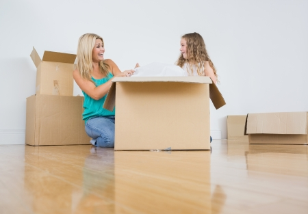 Mother and daughter unpacking together Stock Photo - 16075617