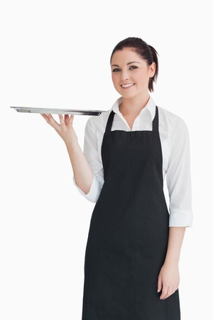 20s waitress: Smiling woman holding an empty silver tray in an apron