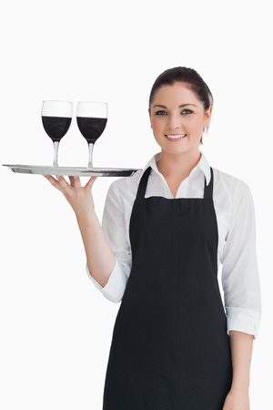 20s waitress: Pretty waitress holding two glasses of wine on a silver tray  Stock Photo