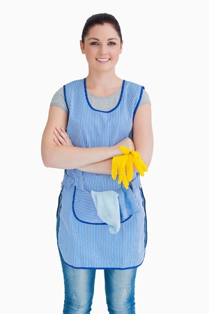 out of context: Cleaner crossing her arms on the white background Stock Photo