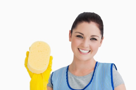 out of context: Cleaning woman showing a sponge on white background