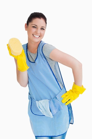 Cleaning woman presenting a sponge on the white background photo