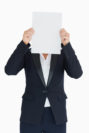 covering face: Business woman holding a white panel in front of her face in the white background