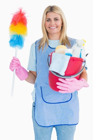 out of context: Cleaning woman holding feather duster with a bucket in the white background Stock Photo