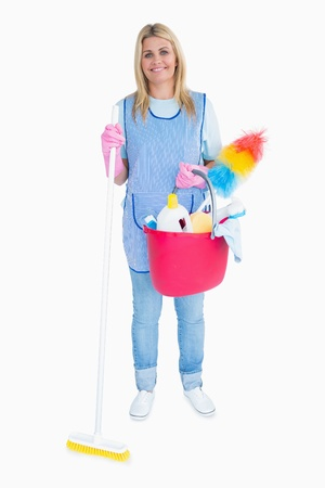 Happy maid holding a pink bucket in the white background photo