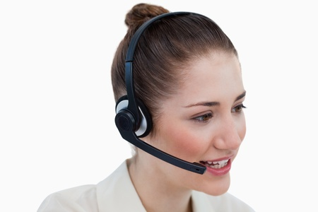 Close up of an operator talking through a headset against a white background Stock Photo - 16069898