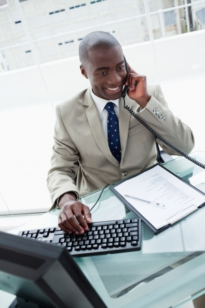 Portrait of a businessman on the phone in his office Stock Photo - 16076274