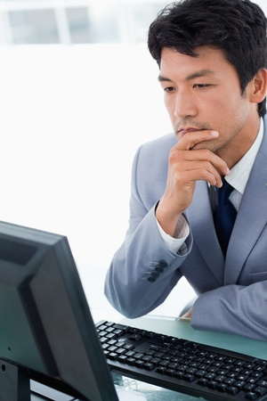 Portrait of an office worker using a monitor in his office Stock Photo - 16076114