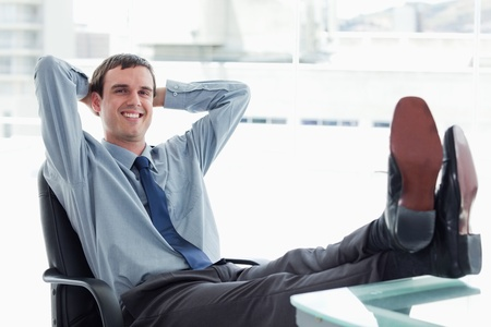blissful: Blissful manager relaxing in his office Stock Photo