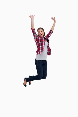 Portrait of a cheerful woman jumping against a white background Stock Photo - 16068904