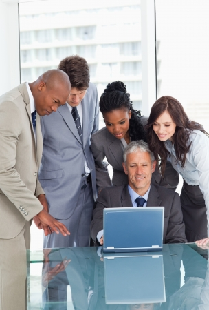 earnestly: Young business team earnestly listening to their mature manager  Stock Photo
