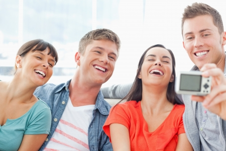 A laughing group of friends pose for a great photo together Stock Photo - 16237032