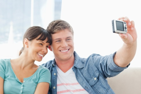 A couple pose for a photo together by smiling and pressing near each other. Stock Photo - 16235011