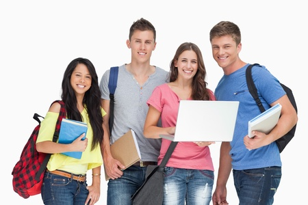 bookbag: A group of smiling students looking at the camera while one holds a laptop