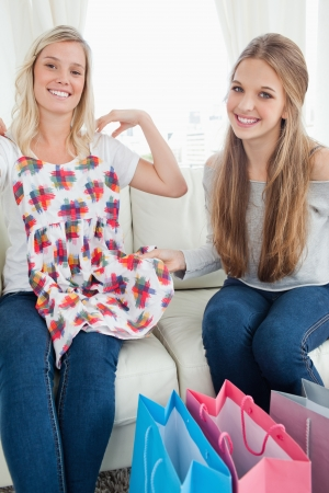 A pair of girls trying on new clothing as they look into the camera Stock Photo - 16238226