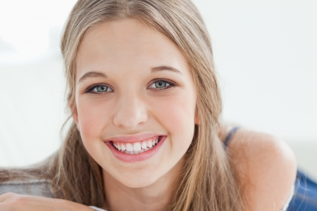 A girl looking at the camera as she smiles Stock Photo - 16236355