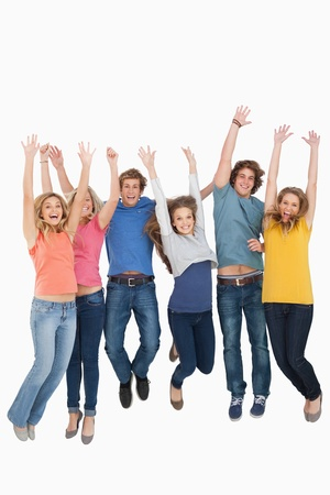 Full length shot of friends celebrating and jumping in the air while looking at the camera Stock Photo - 16234817
