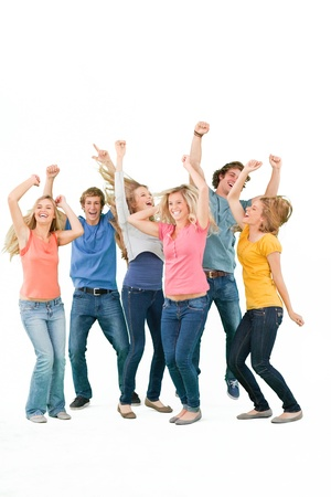 A group of partying friends smiling and laughing and dancing Stock Photo - 16235092
