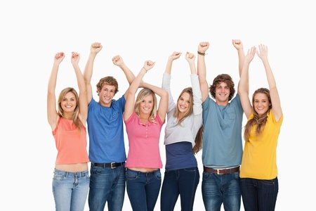 A smiling group of friends looking at the camera with their hands raised up Stock Photo - 16234895