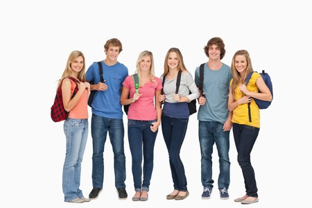 Smiling group with backpacks on as they smile and look at the camera  Stock Photo - 16234885