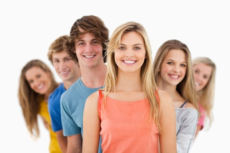 A smiling group standing behind one another at varied angles Stock Photo - 16236079