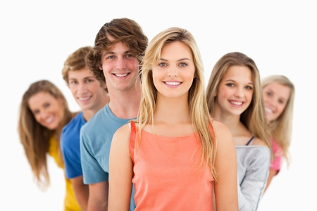 A group standing behind one another at varied angles looking at the camera Stock Photo - 16237024