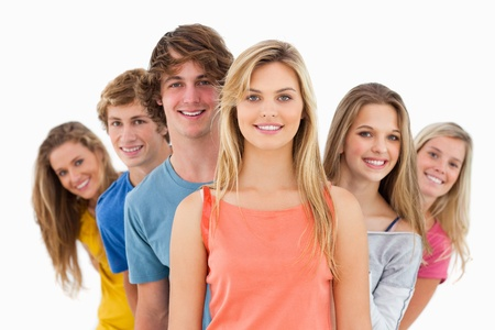 Smiling group standing behind one another at vaus angles while looking at the camera Stock Photo - 16238003