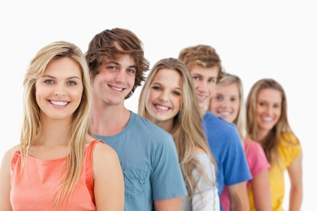 A group standing behind one another at an angle while looking at the camera Stock Photo - 16237285
