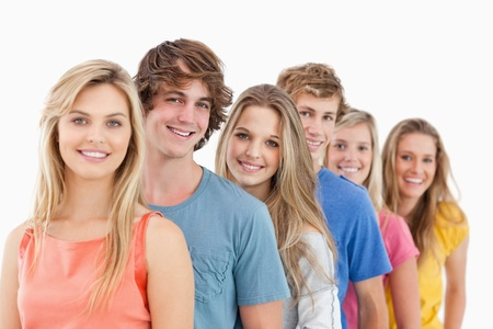 A smiling group standing behind each other at an angle while looking at the camera Stock Photo - 16237514