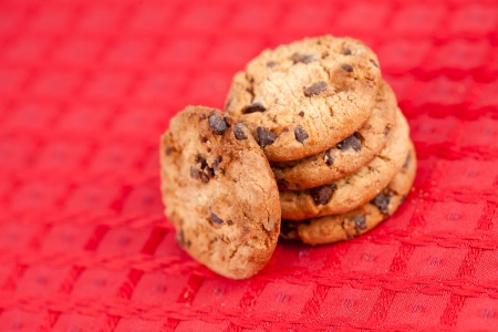 Five cookies laid out together on a red tablecloth photo