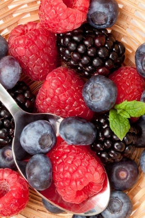 Berries eating in a basket in a high angle view photo