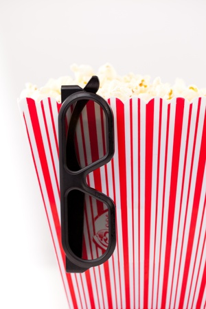 3D Glasses hanging on a striped box full of popcorn Stock Photo - 16203508