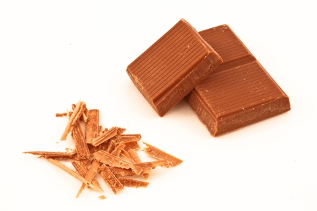 chocolate shavings: Chocolate pieces and chocolate shavings against a white background Stock Photo